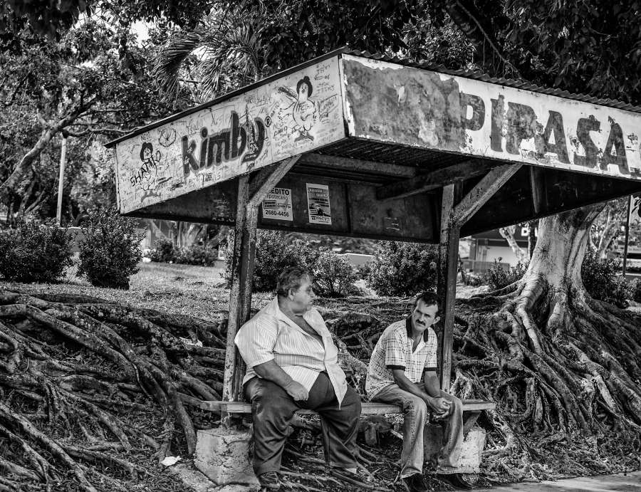 Men waiting at the bus stop (Costa Rica, near La Fortuna)