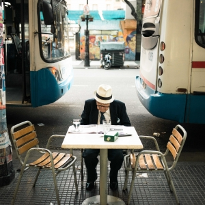 Old man between buses